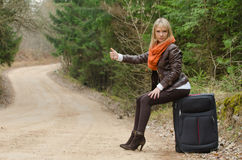 Pretty girl hitchhiking Stock Photo