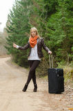 Pretty girl hitchhiking Stock Image