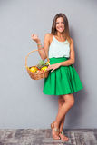 Pretty girl holding basket with fruits Royalty Free Stock Image