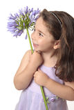 Pretty girl holding a beautiful flower Royalty Free Stock Photography