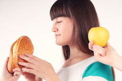 Pretty girl holding and biting loaf of bread Royalty Free Stock Photography