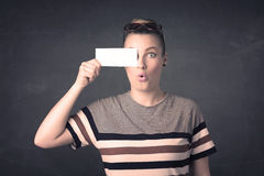 Pretty girl holding blank copy space paper at her eyes Stock Photography