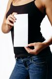 Pretty Girl Holding Blank Media. Pretty girl holding white blank media, against white royalty free stock photography