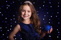 Pretty girl is holding blue christmas ball Stock Photography