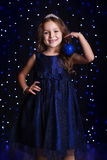 Pretty girl is holding blue christmas ball Stock Images