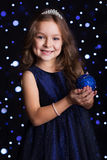 Pretty girl is holding blue Christmas tree toy Stock Image