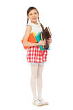 Pretty girl holding books Stock Image