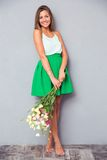 Pretty girl holding bouquet with flowers Royalty Free Stock Photos