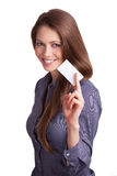 Pretty girl holding a business card. Dark-haired pretty girl holding a business card in hand Stock Photo