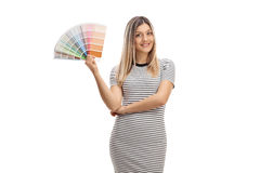 Pretty girl holding a color swatch and smiling Stock Photos