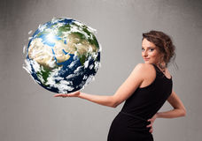 Pretty girl holding 3d planet earth Royalty Free Stock Photos