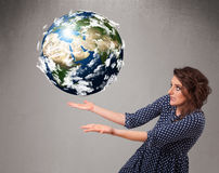 Pretty girl holding 3d planet earth Stock Photography