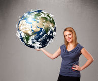 Pretty girl holding 3d planet earth Stock Photo