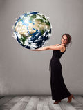 Pretty girl holding 3d planet earth Stock Photos