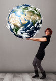Pretty girl holding 3d planet earth Royalty Free Stock Photography