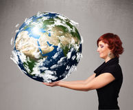 Pretty girl holding 3d planet earth Royalty Free Stock Photo