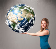 Pretty girl holding 3d planet earth Stock Image