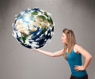 Pretty girl holding 3d planet earth Royalty Free Stock Image