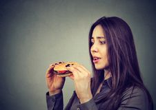 Young woman craving for burger royalty free stock photos