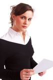 Pretty girl holding document. Portrait of a pretty girl holding a document Royalty Free Stock Images