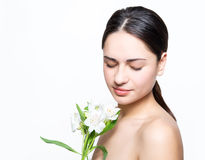 Pretty girl holding a flower and relaxes Stock Photo