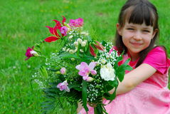 Pretty girl holding flowers Royalty Free Stock Image