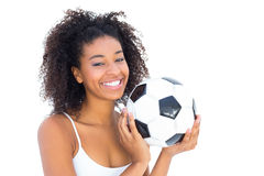 Pretty girl holding football and smiling at camera Royalty Free Stock Photos