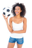 Pretty girl holding football and smiling at camera Stock Photography