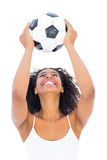 Pretty girl holding football and smiling Royalty Free Stock Images