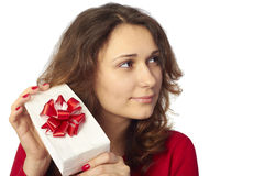 Pretty girl holding a gift. Royalty Free Stock Photo