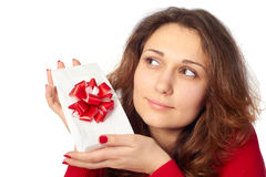 Pretty girl holding a gift. Royalty Free Stock Photography