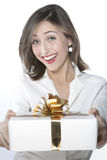Pretty girl holding a gift Stock Photography