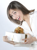Pretty girl holding a gift Royalty Free Stock Image