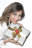 Pretty girl holding a gift Stock Photo