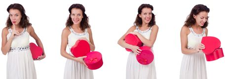 The pretty girl holding gift box isolated on white Stock Photography