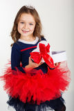 Pretty girl is holding gift box with red ribbon Royalty Free Stock Image