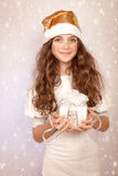 Pretty girl holding gift box Stock Image