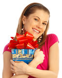 Pretty girl holding a gift. Isolated on white Royalty Free Stock Photo