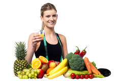Pretty girl holding glass of fresh juice Royalty Free Stock Images
