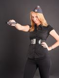 Pretty girl holding a gun Stock Images