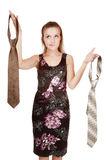 This or that?. Pretty girl holding in hands men's ties and choosing one of them... or maybe one of two men Royalty Free Stock Images