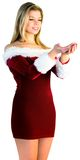 Pretty girl holding hands out in santa outfit Royalty Free Stock Image
