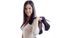 Pretty girl holding her heels Stock Photography