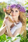 Pretty girl is holding her small dog Royalty Free Stock Photo