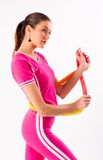 Pretty girl holding hula hoop Stock Images