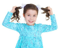 The pretty girl holding itself for braid. Stock Photo