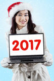 Pretty girl holding laptop with 2017 Stock Photos