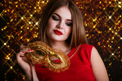 Pretty girl is holding mask royalty free stock images