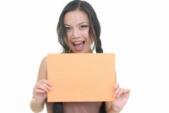Pretty girl holding orange card Royalty Free Stock Photography