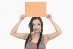 Pretty girl holding orange card Stock Photo